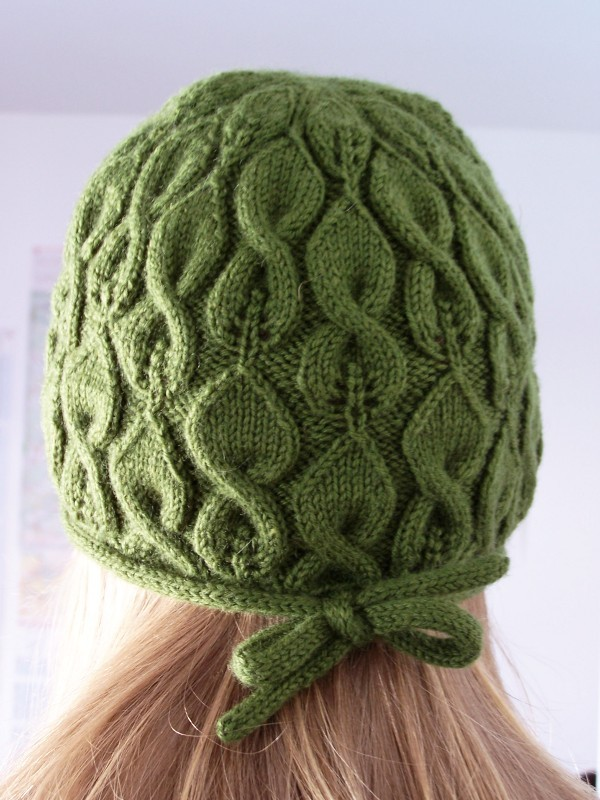 Photos of cable and lace knitted hat pattern